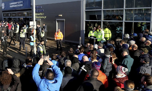 Soccer fans crowd outside the Cardiff City soccer stadium ahead of the English Championship match against Swansea City